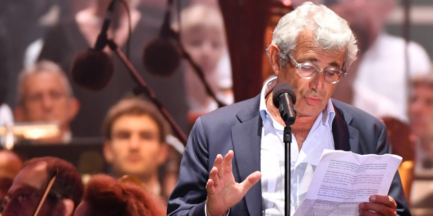 French actor Michel Boujenah reads a text, on stage, during a commemorative ceremony marking the first anniversary of the jihadist truck attack which killed 86 people in Nice, southern France, on Bastille Day, July 14, 2017.