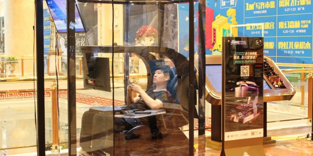 This photo taken on July 14, 2017 shows a man playing video games in a booth at a shopping mall in Shanghai.