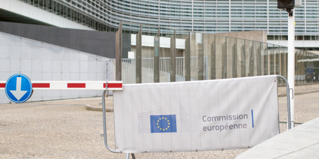 A European Union (EU) flag sits on a barrier outside the European Commission Berlaymont building in Brussels, Belgium, on Thursday, March 30, 2017. Prime Minister Theresa May kickstarted the formal withdrawal from the European Union on Wednesday, leaving businesses and investors facing the realities of Brexit and changes to everything from regulation to the movement of workers and goods. Photographer: Jasper Juinen/Bloomberg via Getty Images