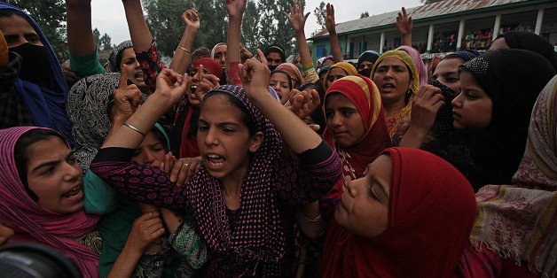 INDIA - 2017/07/18: Girls shout pro freedom slogans during the funeral of Showkat Ahmad Lohar a rebel of Lashkar-e-Toiba rebel outfit in south Kashmir's Bijbehara some 45 kilometers from Srinagar the summer capital of Indian controlled Kashmir on July 18, 2017. Showkat was killed with two other rebels when government forces ambushed the rebels in south Kashmir's Anantnag.