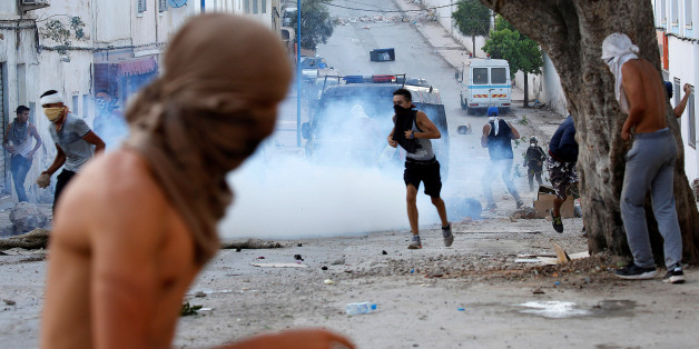 Protesters throw stones against riot police during a demonstration against alleged corruption in the town of Al-Hoceima, Morocco July 20, 2017. REUTERS/Youssef Boudlal