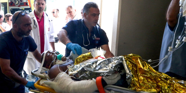 Emergency workers use a trolley to take as a person injured in an earthquake on the Greek island of Kos as they arrive for treatment on the island of Crete in Heraklion on July 21, 2017.  Two foreigners died and more than 100 people were injured on the Greek island of Kos when an earthquake shook popular Greek and Turkish holiday destinations in the Aegean Sea. The epicentre of the 6.7 magnitude quake was some 10.3 kilometres (6.4 miles) south of the major Turkish resort of Bodrum, a magnet for