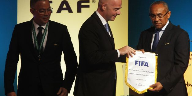 Recently elected president of the African Football Confederation (CAF) Ahmad Ahmad (R), FIFA president Gianni Infantino (C) and Royal Moroccan Football Federation president Fouzi Lekjaa  attend the first ever African Football Symposium in Skhirat, on the outskirts of the Moroccan capital, on July 18, 2017. Delegates from CAF's 55 member federations, coaches, retired players as well as top football officials from FIFA are in the Moroccan capital to discuss, among other issues, the future of Afric