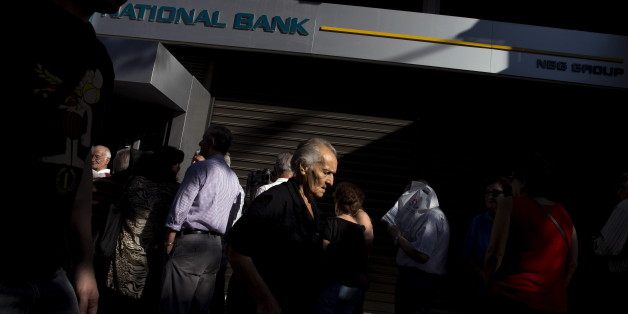 People queue to receive their pensions in front of a National Bank in Athens, Greece, July 2, 2015. Long lines of pensioners jostling to get into a limited number of banks opened specially to pay out retirement benefits have become a powerful symbol of the misery facing Greece and the problems mounting for Prime Minister Alexis Tsipras. REUTERS/Marko Djurica