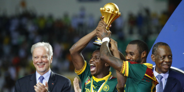 Football Soccer - African Cup of Nations - Final - Egypt v Cameroon - Stade d'Angondjé - Libreville, Gabon - 5/2/17 Cameroon's Benjamin Moukandjo and Nicolas Nkoulou celebrate with the trophy and teammates after winning the African Cup of Nations Reuters / Mike Hutchings Livepic