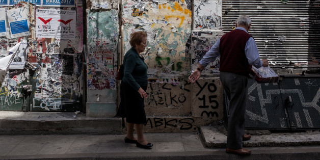 An elderly couple walks in Central Athens in front of closed shops on May 8, 2017.  Greece reached an agreement with its lenders during last week. The weight of this agreement is left on Greek people to carry and especially the pensioners. (Photo by Kostis Ntantamis/NurPhoto via Getty Images)
