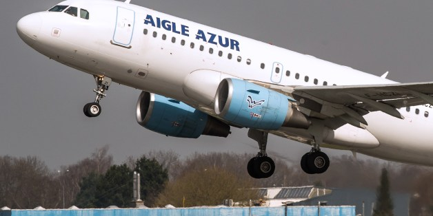An Airbus A318 airplane of the French airline Aigle Azur takes off from Lille Airport in Lesquin on April 10, 2015. AFP PHOTO / PHILIPPE HUGUEN        (Photo credit should read PHILIPPE HUGUEN/AFP/Getty Images)