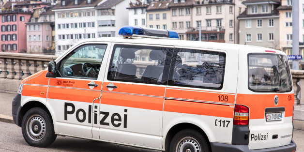 Zurich, Switzerland - 4 December, 2015: a parked van of Zurich Municipal Police, old town buildings in the background. Zurich Municipal Police is the third largest police corps in Switzerland, after Zurich Cantonal Police and Bern Cantonal Police. Zurich is the largest city of the country.