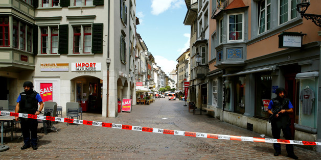 Swiss police officers stand at a crime scene in Schaffhausen, Switzerland July 24, 2017. REUTERS/Arnd Wiegmann
