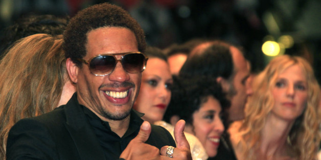 "Actor Joey Starr gestures as he arrives on the red carpet for the screening of the film ""Polisse"", by director Maiwenn, in competition at the 64th Cannes Film Festival, May 13, 2011.          REUTERS/Jean-Paul Pelissier (FRANCE - Tags: ENTERTAINMENT)"