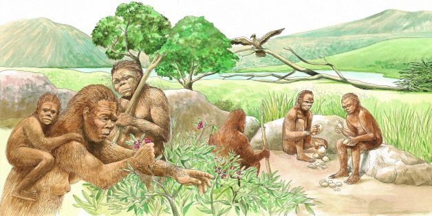 Homo habilis men chip away at rocks, sharpening them for cutting up game or scraping hides. The game would be trapped in a pit or run down by several men. A woman, with her child, gathers wild berries. Branches were collected to make shelters. (Photo by: Brown Bear/Windmil Books/UIG via Getty Images)