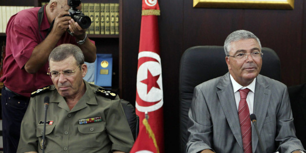 Tunisia's Armed Forces General Rachid Ammar (L) and Tunisian Defence Minister Abdelkarim Zbidi attend a meeting with U.S. Defense Secretary Leon Panetta (not in picture) in Tunis July 30, 2012.  REUTERS/Zoubeir Souissi (TUNISIA - Tags: POLITICS MILITARY)