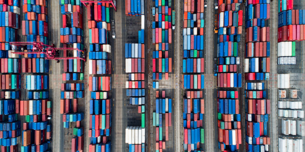 Shipping containers sit stacked in this aerial photograph taken above the Busan Port Terminal (BPT) in Busan, South Korea, on Monday, July 17, 2017. South Korea's exports will continue to rise in July and the third quarter as global trade continues to recover and unit costs rise, especially in sectors including semiconductors, vessels, petroleum goods and steel, according to a statement from the trade ministry. Photographer: SeongJoon Cho/Bloomberg via Getty Images