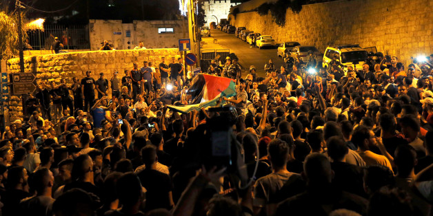 Palestinians celebrate outside Lion's gate at the entrance to Jerusalem's Old City following Israel's removal of security measures July 27, 2017. REUTERS/Muammar Awad