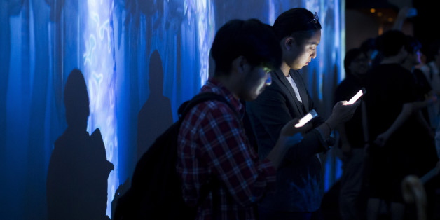 TOKYO, JAPAN - JULY 27:  Visitors use smartphones as they stand in front of a digital installation produced by teamLab, an art collective, during the teamLab Jungle Light Art and Music Festival & Learn and Play! Future Park exhibition at the Shibuya Hikarie commercial complex on July 27, 2017 in Tokyo, Japan. The exhibition is opened to the public through September 10 to commemorate Shibuya Hikarie's 5th anniversary since its establishment.  (Photo by Tomohiro Ohsumi/Getty Images)