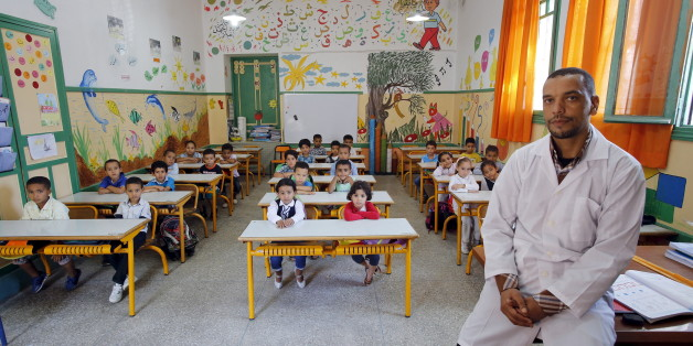 Teacher Moulay Ismael Lamrani poses for a picture with his class in the Oudaya primary school in Rabat, September 15, 2015, at the start of the new school year in Morocco. Nearly three years after Taliban gunmen shot Pakistani schoolgirl Malala Yousafzai, the teenage activist last week urged world leaders gathered in New York to help millions more children go to school. World Teachers' Day falls on 5 October, a Unesco initiative highlighting the work of educators struggling to teach children ami