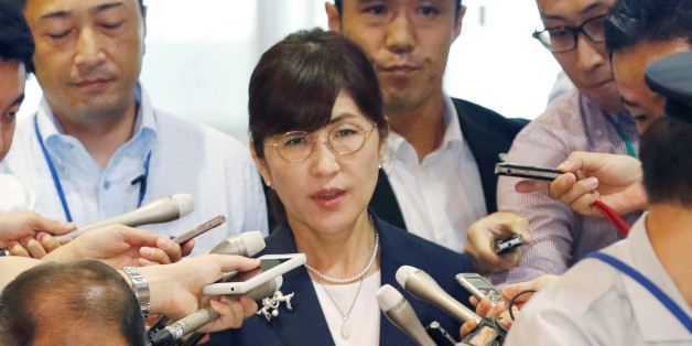 Japan's Defence Minister Tomomi Inada is surrounded by reporters as she arrives at Defence Ministry in Tokyo, Japan in this photo taken by Kyodo on July 27, 2017. Mandatory credit Kyodo/via REUTERS ATTENTION EDITORS - THIS IMAGE WAS PROVIDED BY A THIRD PARTY. MANDATORY CREDIT. JAPAN OUT. NO COMMERCIAL OR EDITORIAL SALES IN JAPAN. THIS PICTURE WAS PROCESSED BY REUTERS TO ENHANCE QUALITY. AN UNPROCESSED VERSION HAS BEEN PROVIDED SEPARATELY.