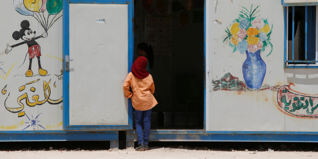 A Syrian girl looks into a room at a school run by Relief International in Al Zaatari refugee camp outside the city of Mafraq in Jordan, near the border with Syria, July 17, 2017. Picture taken July 17, 2017. REUTERS/Darrin Zammit Lupi