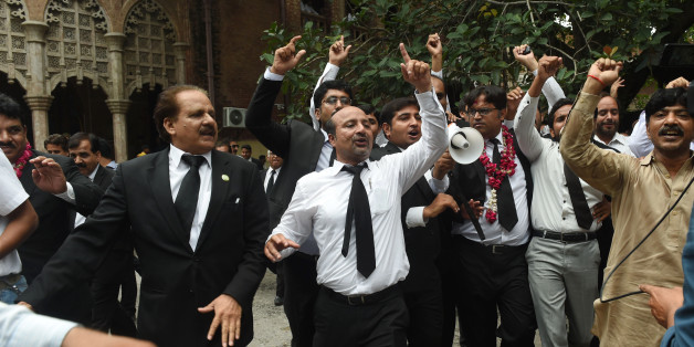 Pakistani lawyers celebrate the Supreme Court (SC) against Prime Minister Nawaz Sharif, in Lahore on July 28, 2017. Pakistan's Supreme Court on July 28 disqualified Prime Minister Nawaz Sharif from public office over long-running corruption allegations, a decision that ousts him from the premiership for the third time in a chequered political career. / AFP PHOTO / ARIF ALI        (Photo credit should read ARIF ALI/AFP/Getty Images)