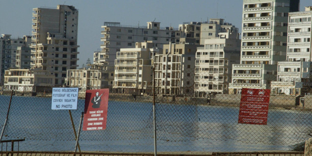 A view of the ghost town of Famagusta is seen in northern Cyprus, May 2, 2003. Cyprus has been ethnically separated since Turkey invaded on July 20, 1974, and seized the northern third of territory, five days after a Greek Cypriot coup aimed at union with Greece. Barbed wire and concrete-filled oil drums surround Maria Riri Myles' family apartment in a snake- and rat-infested no-go zone of northern Cyprus occupied only by patrolling Turkish soldiers. But it still feels like home. Myles' hometown of Varosha, now an eerie collection of derelict high-rise hotels, churches and residences, once drew luxury-seeking Hollywood stars like Paul Newman and Elizabeth Taylor. Deserted since a 1974 war that split the island, it is now the ultimate bargaining chip in the decades-long stand-off between Greek Cypriots and Turkish Cypriots. Picture taken May 2, 2003. To match Feature CYPRUS-TOWN/TURKEY     REUTERS/Andreas Manolis (CYPRUS - Tags: CITYSPACE SOCIETY)