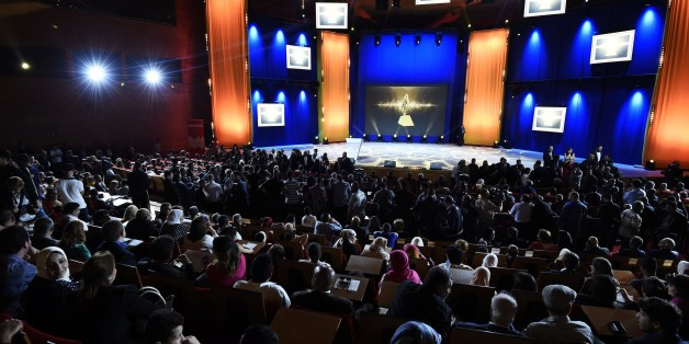 People attend the 8th International Arab Film Festival (FIOFA) on June 3, 2015, in Oran Algeria. A total of 38 films from 17 Arab and Western countries are in competition during the festival.  AFP PHOTO/FAROUK BATICHE        (Photo credit should read FAROUK BATICHE/AFP/Getty Images)