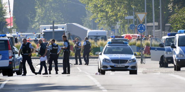 Police and ambulances stand near the disco Club Grey in the southern German town of Konstanz, where a gunman opened fire, killing one and wounding four people before being shot by police, on July 30, 2017. The 34-year-old attacker 'was critically injured in a shootout with police officers as he left the disco, and later succumbed to his wounds in hospital,' police said in a statement. / AFP PHOTO / dpa / Felix Kästle / Germany OUT        (Photo credit should read FELIX KASTLE/AFP/Getty Images