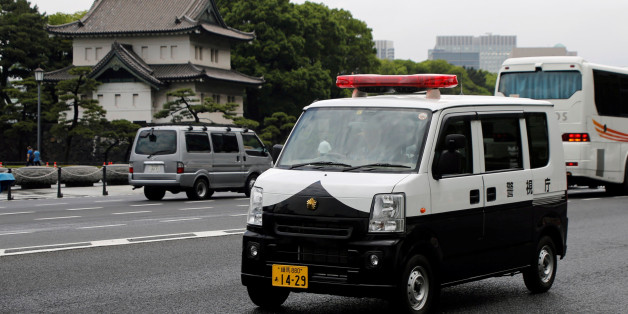 A police car of Suzuki Motor - Every, drives past the Imperial Palace in Tokyo, Japan June 1, 2017. REUTERS/Toru Hanai