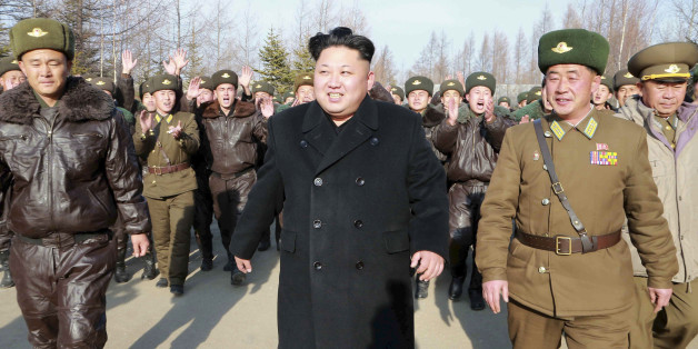 North Korean leader Kim Jong Un walks as he inspects the KPA Air and Anti-Air Force Unit 991, honoured with the title of O Jung Hup-led Seventh Regiment, in this undated photo released by North Korea's Korean Central News Agency (KCNA) in Pyongyang November 21, 2014. REUTERS/KCNA (NORTH KOREA - Tags: POLITICS MILITARY TRANSPORT)ATTENTION EDITORS - THIS PICTURE WAS PROVIDED BY A THIRD PARTY. REUTERS IS UNABLE TO INDEPENDENTLY VERIFY THE AUTHENTICITY, CONTENT, LOCATION OR DATE OF THIS IMAGE. FOR E