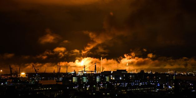 A photo taken at night on July 29, 2017 shows flames and smoke rising above the Shell refinery in Rotterdam.A fire broke out on the night of July 29 at the Shell refinery in Rotterdam, the largest in Europe, causing part of the site to be shut down. / AFP PHOTO / ANP / Björn Remmerswaal / Netherlands OUT        (Photo credit should read BJORN REMMERSWAAL/AFP/Getty Images)