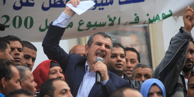 TUNIS, TUNISIA - OCTOBER 31: Leader of the Tayyar al-Mahhab Party, Hachmi Hamdi, gives a speech during a protest against Tunisian government's economical policies at Avenue Habib Bourguiba in Tunis, Tunisia on October 31, 2015. (Photo by Yassine Gaidi/Anadolu Agency/Getty Images)