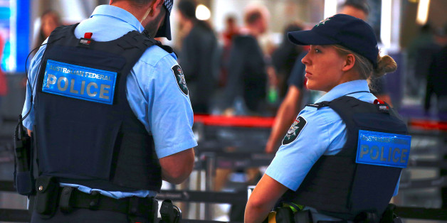 Australian Federal Police officers stand near the check-in counters at the Sydney Airport Domestic terminal in Australia, July 30, 2017.      REUTERS/David Gray