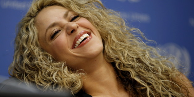 Colombian singer and UNICEF Goodwill Ambassador Shakira laughs during a news conference at United Nations headquarters in New York, September 22, 2015. Shakira and UNICEF were calling for the urgent need for increased investment in early childhood development ahead of 70th United Nations General Assembly which convenes September 28.   REUTERS/Mike Segar