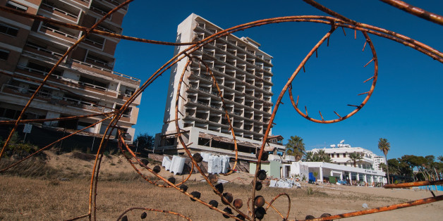 FAMAGUSTA, CYPRUS - JANUARY 05:  An abandoned hotel is seen in the Varosha quarter of the beach on January 5, 2017 in Famagusta, Cyprus. Prior to the Turkish invasion of Cyprus in 1974, the abandoned quarter of Varosha was the modern tourist area of the city, and one of the most important tourist destinations in the world.  (Photo by Awakening/Getty Images)