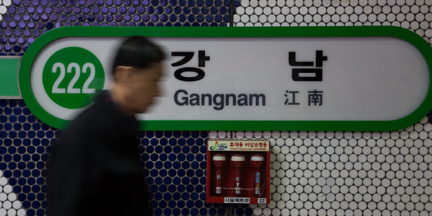 A man walks past signage for Gangnam subway station in Seoul, South Korea, on Thursday, Dec. 13, 2012. South Koreans vote on Dec. 19 to replace President Lee Myung Bak, whose five-year term ends in February. Photographer: SeongJoon Cho/Bloomberg via Getty Images