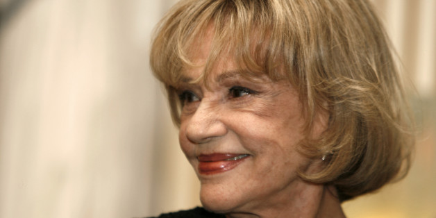 French actress Jeanne Moreau poses before being awarded Commandeur de la Legion d'Honneur during a ceremony at the Culture Ministry in Paris,  January 9, 2007.  REUTERS/Charles Platiau  (FRANCE)