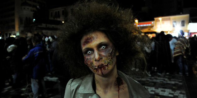 """A woman dressed as zombie walks through the city centre during an annual """"Zombie Walk"""" parade in Athens, Greece, February 25, 2017. REUTERS/Michalis Karagiannis"""