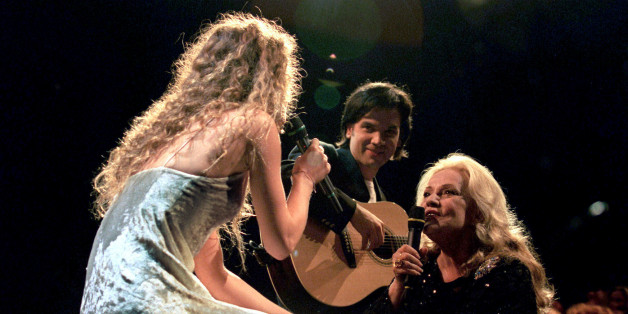 FILE PHOTO - Jeanne Moreau (R), President of the Jury at the 48th Cannes Film Festival, sings with Vanessa Paradis as part of the opening evening program of the festival in Cannes, France, May 17, 1995. Actress Jeanne Moreau has died, aged 89, in Paris, France, July 31, 2017. Picture taken May 17, 1995.     REUTERS/Stringer/File Photo