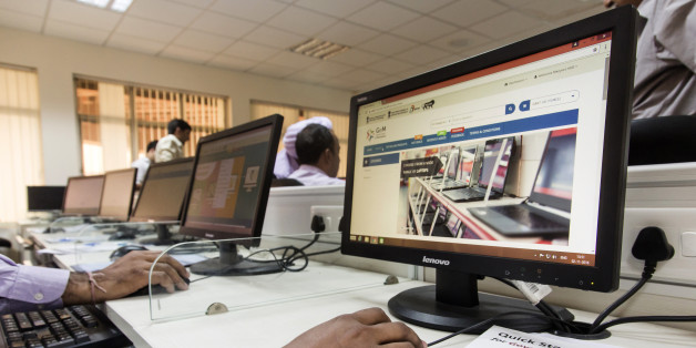A trainee uses a mouse while sitting in front of a computer screen displaying the Government e Marketplace (GeM) website during a class at the National Institute of Financial Management in Faridabad, Haryana, India, on Wednesday, Nov. 2, 2016. India's Prime Minister Narendra Modi plans to move all government purchases, from paper clips to power plant turbines, to an Amazon-like online marketplace that could eventually be worth a fifth of the country's $2 trillion economy. Photographer: Udit Kuls