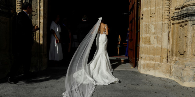 """A woman walks into a church before getting married in the white village of Espera, southern Spain September 10, 2016. REUTERS/Marcelo del Pozo     SEARCH """"PUEBLOS BLANCOS"""" FOR THIS STORY. SEARCH """"WIDER IMAGE"""" FOR ALL STORIES."""