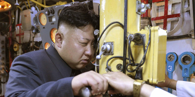 North Korean leader Kim Jong Un looks through a periscope of a submarine during his inspection of the Korean People's Army (KPA) Naval Unit 167 in this undated photo released by North Korea's Korean Central News Agency (KCNA) in Pyongyang June 16, 2014. REUTERS/KCNA (NORTH KOREA - Tags: POLITICS MILITARY MARITIME TPX IMAGES OF THE DAY) ATTENTION EDITORS - THIS PICTURE WAS PROVIDED BY A THIRD PARTY. REUTERS IS UNABLE TO INDEPENDENTLY VERIFY THE AUTHENTICITY, CONTENT, LOCATION OR DATE OF THIS IMAGE. THIS PICTURE WAS PROCESSED BY REUTERS TO ENHANCE QUALITY. AN UNPROCESSED VERSION WAS PROVIDED SEPARATELY. FOR EDITORIAL USE ONLY. NOT FOR SALE FOR MARKETING OR ADVERTISING CAMPAIGNS. THIS IMAGE HAS BEEN SUPPLIED BY A THIRD PARTY. IT IS DISTRIBUTED, EXACTLY AS RECEIVED BY REUTERS, AS A SERVICE TO CLIENTS. NO THIRD PARTY SALES. NOT FOR USE BY REUTERS THIRD PARTY DISTRIBUTORS. SOUTH KOREA OUT. NO COMMERCIAL OR EDITORIAL SALES IN SOUTH KOREA