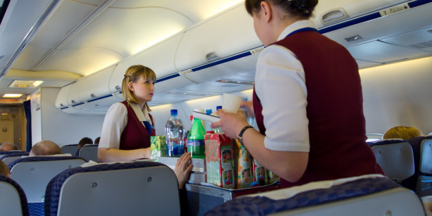 Moscow, Russia - May 14, 2013: Flight attendants serve passengers of UT-578 airlines UTair.