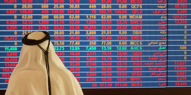 A trader monitors a screen displaying stock information at Qatar Stock Exchange in Doha, Qatar November 9, 2016. REUTERS/Naseem Zeitoon