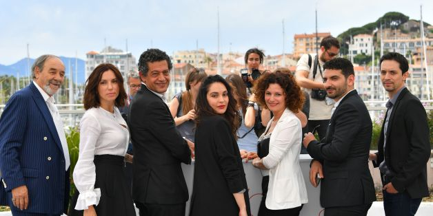(FromL) Algerian actor Mohamed Djouhri, French actress Aure Atika, Algerian actor Hassan Kachach, Algerian actress Hania Amar, Algerian actress Nadia Kaci, Algerian director Karim Moussaoui and Algerian actor Mehdi Ramdani pose on May 22, 2017 during a photocall for the film 'Until the Birds Return' (En Attendant les Hirondelles) at the 70th edition of the Cannes Film Festival in Cannes, southern France.  / AFP PHOTO / LOIC VENANCE        (Photo credit should read LOIC VENANCE/AFP/Getty Images)