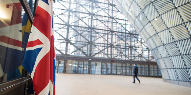 The U.K.'s Union Flag, also known as Union Jack, left, hangs inside the European Union's (EU) new Europa building, also known as the Space Egg, ahead of a Eurogroup meeting of euro-area finance ministers in Brussels, Belgium, on Thursday, Jan. 26, 2017. Greece has less than a month to iron out disagreements with its creditors over how to move forward with a rescue package that has been keeping the country afloat since 2010.Photographer: Jasper Juinen/Bloomberg via Getty Images