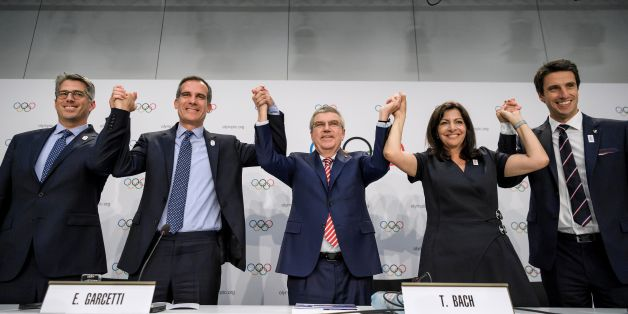(L-R) Los Angeles 2024 Olympic bid's Chairman Casey Wasserman, Los Angeles' Mayor Eric Garcetti, International Olympic Committee (IOC)'s President German Thomas Bach, Mayor of Paris Anne Hidalgo and Paris 2024 Olympic bid's Co-president Tony Estanguet pose during a press conference following an IOC extraordinary session on July 11, 2017 in Lausanne.The International Olympic Committee agreed to award the 2024 and 2028 Games at the same time, effectively guaranteeing that Paris and Los Angeles wil