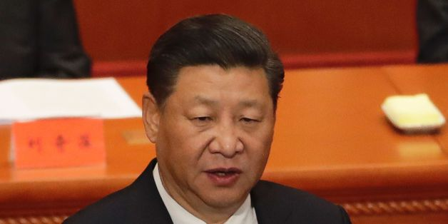 China's President Xi Jinping speaks during a ceremony to commemorate the 90th anniversary of the founding of the People's Liberation Army, at the Great Hall of the People in Beijing on August 1, 2017.China will fiercely protect its sovereignty against 'any people, organisation or political party', President Xi Jinping warned on August 1, as the country celebrated the 90th anniversary of its military, the People's Liberation Army. / AFP PHOTO / POOL / Andy Wong        (Photo credit should read AN