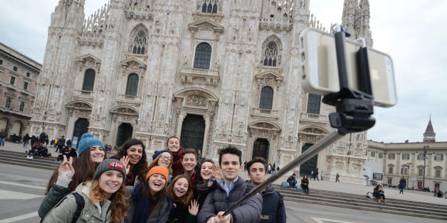 Selfies with the stick has been the trendy fashion 2014 in Italy but with the Expo 2015 in Milan sellers are expecting a booming business. (Photo by Alexandro Auler/Corbis via Getty Images)
