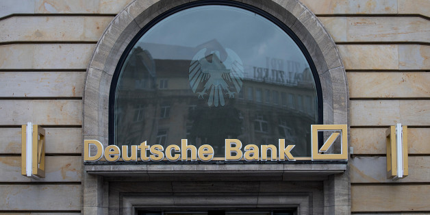 Signage for Deutsche Bank AG sits above a bank branch in Frankfurt, Germany, on Thursday, July 20, 2017. Frankfurt has emerged as a winner of the Brexit vote, with Standard Chartered Plc, Nomura Holdings Inc., Sumitomo Mitsui Financial Group Inc. and Daiwa Securities Group Inc. picking the city as their EU hub in recent weeks. Photographer: Krisztian Bocsi/Bloomberg via Getty Images