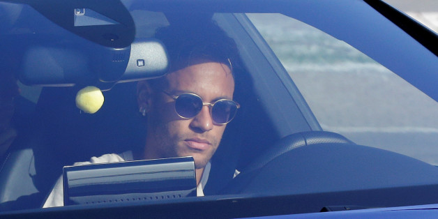 Brazilian soccer player Neymar drives to arrive to Joan Gamper training camp near Barcelona, Spain,  August 2, 2017. REUTERS/Stringer