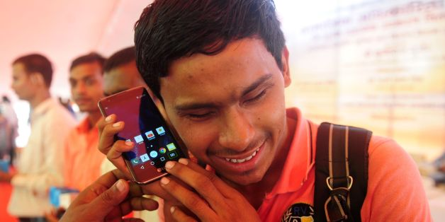 Blind Indian student Parshuram receives a smartphone at a function organized by the India government in Allahabad on September 19, 2016. / AFP / SANJAY KANOJIA        (Photo credit should read SANJAY KANOJIA/AFP/Getty Images)